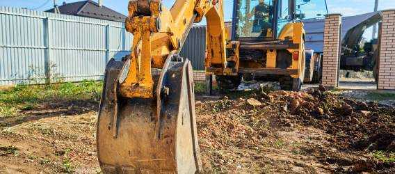 Banner Image - Get the Lead Out - Excavator Digging a Service - AdobeStock_384691445