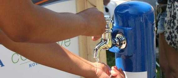 a portable Halifax Water tap being used to wash hands
